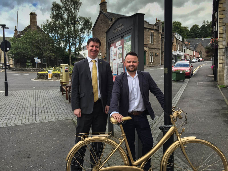 Steven Paterson and Scott Abercrombie and a golden bike