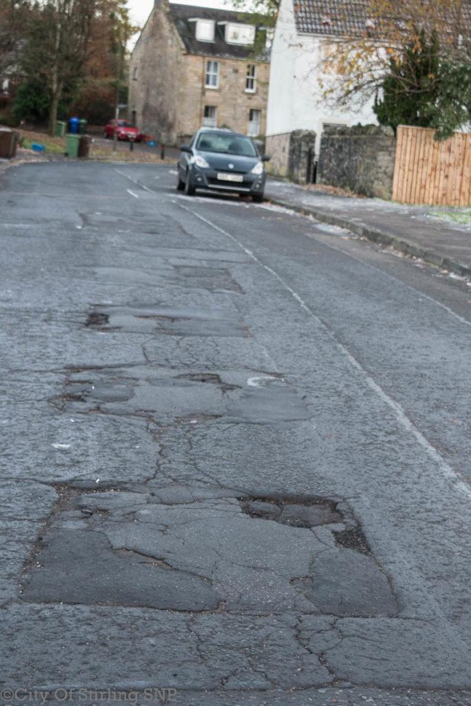Pot holed road in Stirling