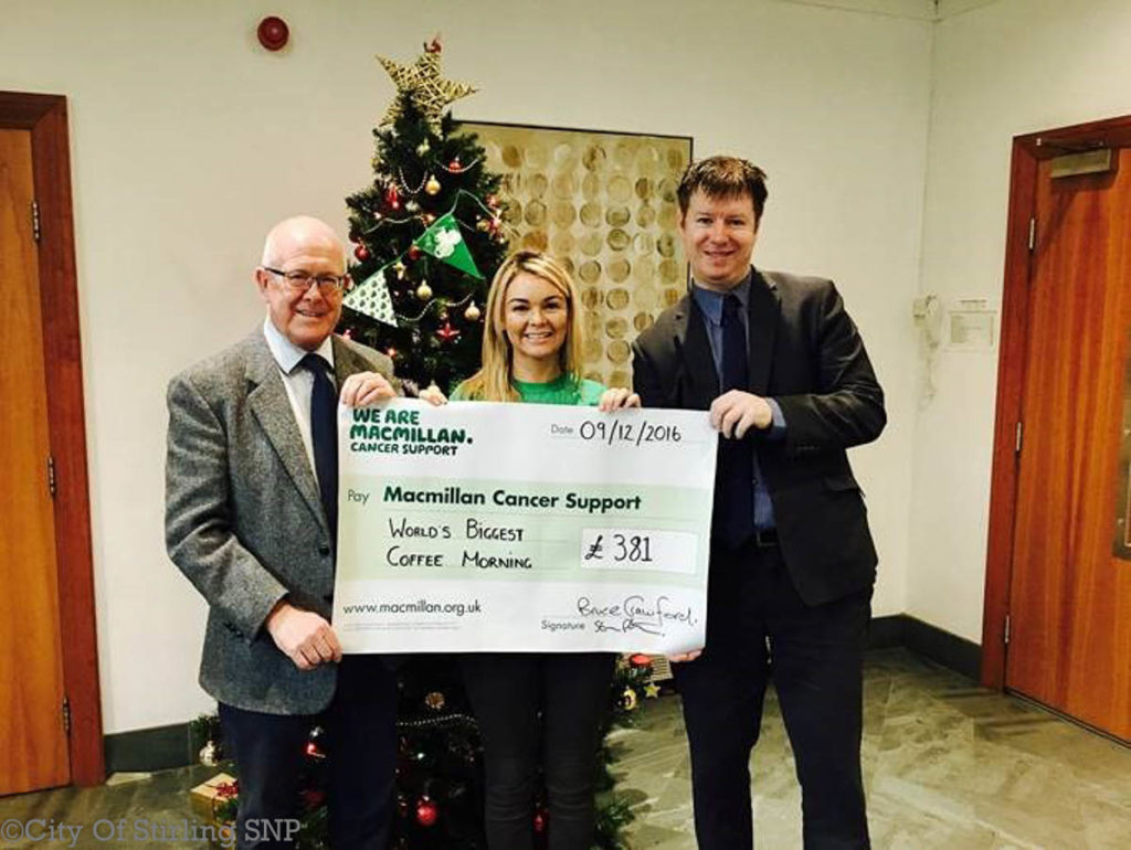 Bruce Crawford MSP and Steven Paterson MP hand over the cheque to MacMillan Cancer Support representative Pauline McMillan